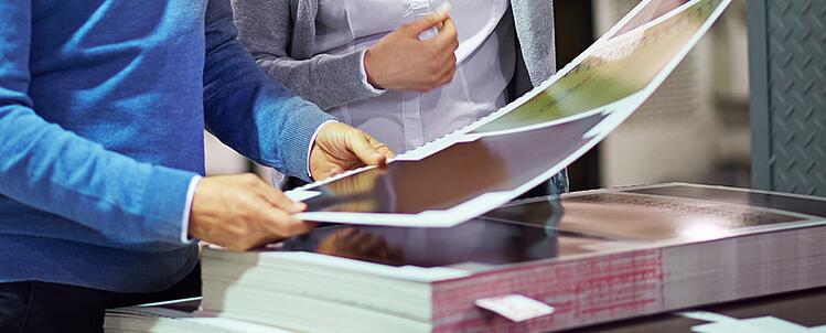 Image of woman inspecting glossy paper sheet