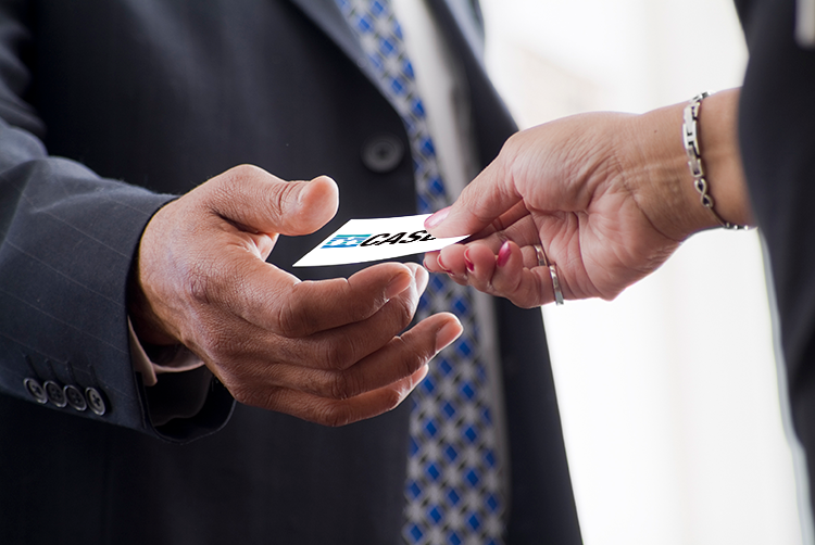 Image of man and woman exchanging business cards
