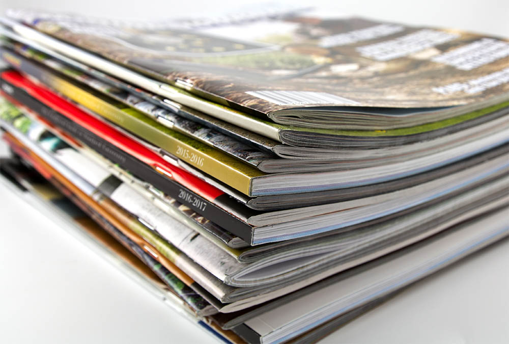 Stack of publications printed by Casey Printing