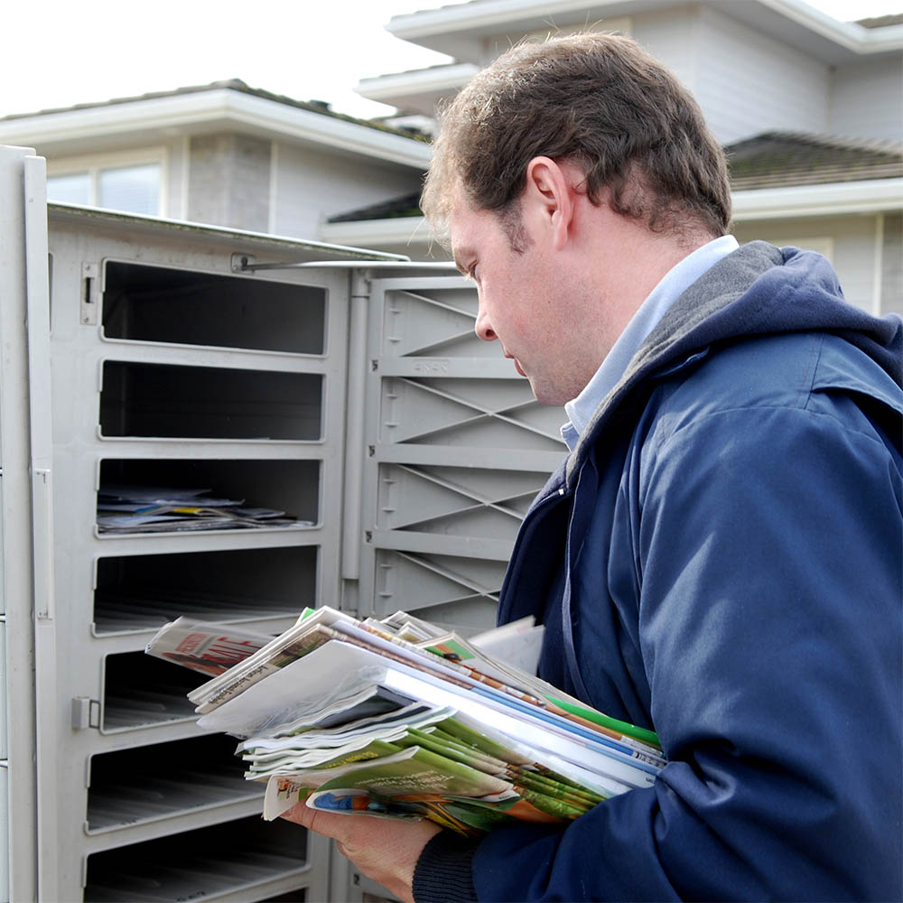 Image of mail man delivering direct mail from CASEY